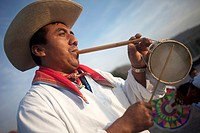 A Totonacan indigenous man plays flute and drums from Papantla, Veracruz, as part of the Dance of the Guaguas at the pilgrimage to Our Lady of Guadalu...
