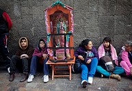 Pilgrims sit by an image of the Virgin of Guadalupe at the pilgrimage to Our Lady of Guadalupe Basilica in Mexico City, Mexico, December 10, 2013.
