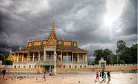 Royal Palace in Phnom Penh Cambodia under cloudy sky with sun.