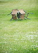 Empty garden patio with vacant chairs and table on big lawn with copy space.