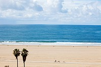 Horizontal aerial view of Santa Monica beach, as seen from the cliffs at Palisades Park, with view of vast expanse of sand, Los Angeles, California, U...