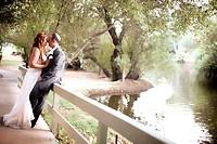 Couple embracing, enjoying the moment and the beautiful lake scenery