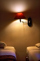Two beds in a hotel room with a lamp, Chiang Mai, Thailand, Southeast Asia.