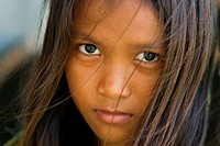Portrait of a Cambodian girl. The population of Cambodia today is about 10 million. About 90-95 percent of the people are Khmer ethnic. The remaining ...