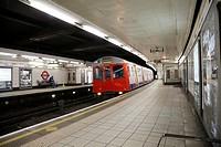 Monument Underground station platform with train pulling in, London, England, United Kingdom, Europe.