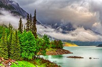 Low hanging clouds on Medicine Lake in Jasper National Park, Alberta, Canada.