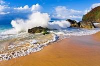 Crashing waves and rocks at Hanakapi´ai Beach, Na Pali Coast, Island of Kauai, Hawaii USA.
