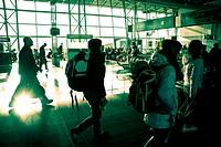 Passengers walking towards departure gates in Brussels airport.