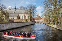 Tourists are boat tripping in Bruges.