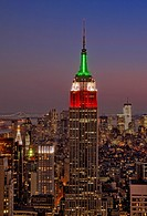 A sunset view from Top Of The Rock in Rockefeller Center in New York City of the Empire State Building along with other skyscrapers. The Verrazano Nar...