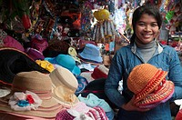 Hat seller at a Cambodian country market in Ratanakiri province.
