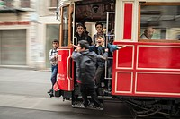 Kids playing on a tram in Istiklal Caddesi, Beyoglu, Istanbul, Turkey,.