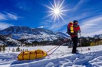 Backcountry skier, John Muir Wilderness, Sierra Nevada Mountains, California USA.