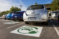 EV symbol painted on parking spaces for to plug-in electric cars in a company parking lot.