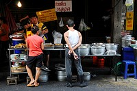 Thais wait for the food at a food stall in Bangkok