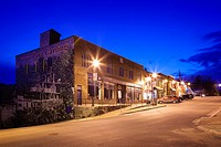 A strip of commercial buildings erected in 1932 with the ´Welcome to Port carling´ mural at dusk in downtown Port Carling, Ontario , Canada.