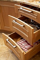 Rounded drawers opened in a modern British kitchen.