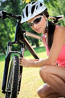 cycling woman taking a break in the park.