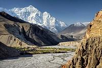 The village of Chuksang (2900m) surrounded by fields in the valley of the Kali Gandaki river, Nilgiri peak (7061m). Nepal, Gandaki, Upper Mustang (nea...