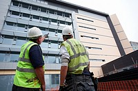 Construction workmen on the development site of the new Institute of Life Science at Swansea university in South Wales UK.