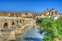 HDR of the Roman Bridge with the Cathedral–Mosque of Córdoba in the background across the Guadalquivir River, Córdoba, Andalusia, Spain,.