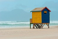 One of the last-standing. A wooden bathing cubicle (change room) stands forlornly on the winter beach at Muizenberg, Cape Town, South Africa