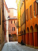 Quiet cobblestone alley with colorful buildings in Modena, Emilia-Romagna, Italy