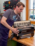 Instrument maker with accordion.