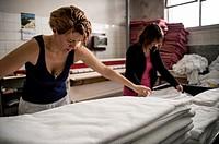 Women in a laundry, Madrid, Spain.