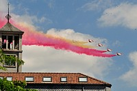 Air Force jets with contrails colors of spanish flag over San Lorenzo de El Escorial (Madrid), Spain.