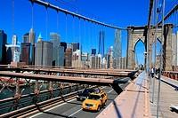 Manhattan skyline view from the Brooklyn bridge, New York City, USA.