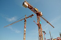 Construction cranes of the company Liebherr at a construction site in Memmingen, Bavaria, Germany