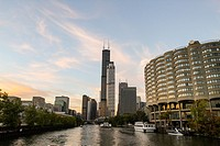 Looking towards Willis Tower, formerly the Sears Tower, from a sightseeing cruise on the Chicago River. Chicago, Illinois, United States.