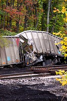 derailed and damaged railroad cars and spilled coal next to railroad track, Monroe County, Indiana.