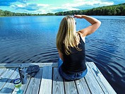 Woman on dock looking out over lake