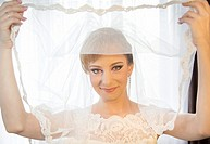 Beautiful young bride holding her veil - Bucharest, Romania, Eastern Europe, Europe.