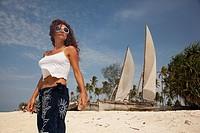 Woman posing at Nungwi beach, Zanzibar, Tanzania, East Africa.