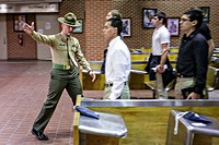 US Marine Corps Drill Instructors direct newly arrived recruits through receiving at Marine Corps Recruit Depot Parris Island to begin 13 weeks of boo...