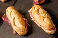 forefront of a group of Iberian ham sandwiches.