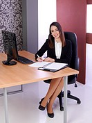 Young attractive business woman in their jobs.