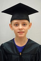 6th Grade Boy in Cap and Gown, Wellsville, New York, United States.