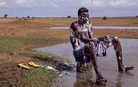Niger, West Africa. Rainy Season in the Sahel--an Unexpected Opportunity to Bathe, if you have soap.