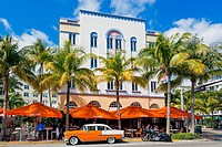 Art Deco building design on Ocean Drive, South Beach Miami, Florida, USA with a cafe restaurant below.