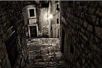 narrow streets of historic part of Sibenic by night, Dalmatia, Croatia.
