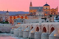 Cathedral (Mezquita) and Roman bridge at sunset, Guadalquivir river, Cordoba, Andalusia, Spain.