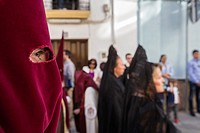 Detail of eye of penitence during a Holy week procession, Spain.