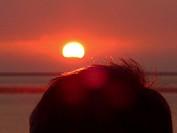 Man´s head with sunset, Island Neuwerk, Elbe estuary, North Sea, Hamburg, Germany.