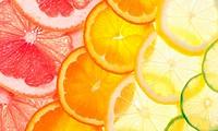Sliced citrus fruits background (grapefruit, orange, lemon, lime).