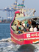 Fishermen traveling on boat at Cochin, Kerala, India.