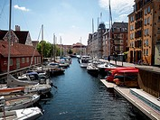 Modern apartments and boats at Christianshavn harbour area,Copenhagen,Denmark.